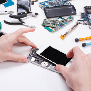 A person opening a smartphone for repair.